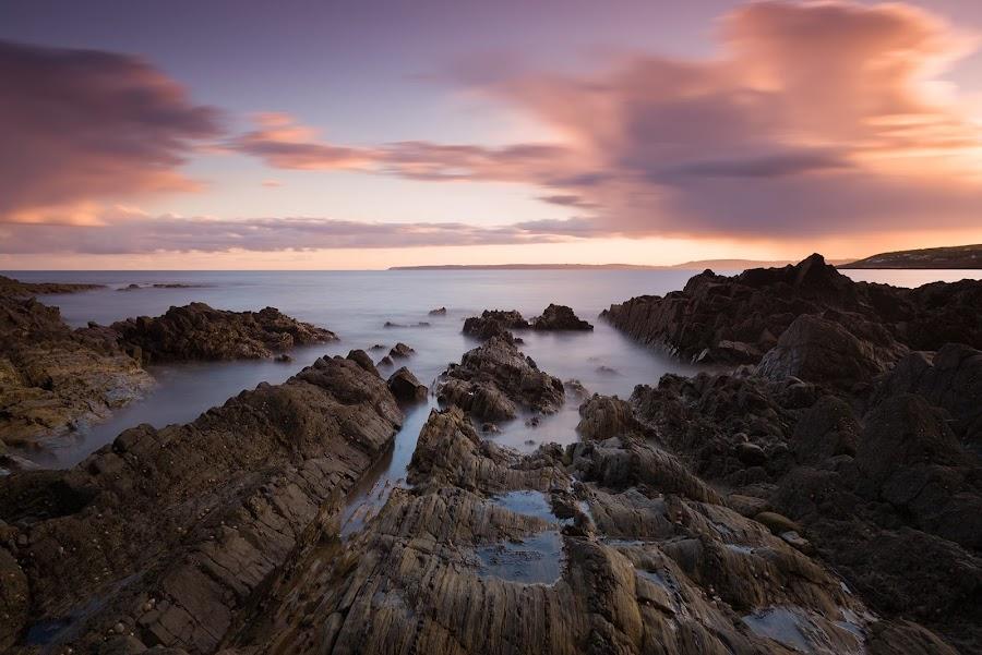 Rocky seascape by Alek Kisielewicz - Landscapes Sunsets & Sunrises ( clouds, ireland, sunset, sea, long exposure, rocks )