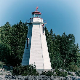 Tobermory Lighthouse by Cece Davidson-Green - Buildings & Architecture Statues & Monuments ( water, white, lighthouse, architecture, rocks )