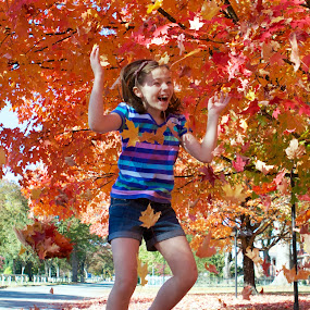 Girl Jumping for Autumn Joy by Joe Proctor - Babies & Children Children Candids ( red, girl, jumping, autumn, leaves )