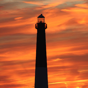 Red Night On The Barnegat Light by Rusty Jhorn - Landscapes Waterscapes ( pwcredscape, sunset, barnegat bay, lighthouse, pwcredscapes, , landmark, travel )