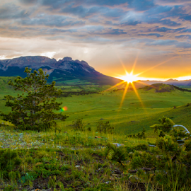 Big Sky Country  by Danny Stankiewicz - Landscapes Mountains & Hills ( clouds, mountains, sky, trees, landscape, sun )