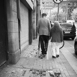 Old folks by Vali Tina - People Couples ( old folks walking city dublin together )