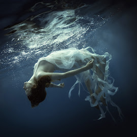 Underwater dreams by Dmitry Laudin - Uncategorized All Uncategorized ( water, reflection, girl, blue, underwater, dress, swim, ribbon, white, dive, darkness, light )