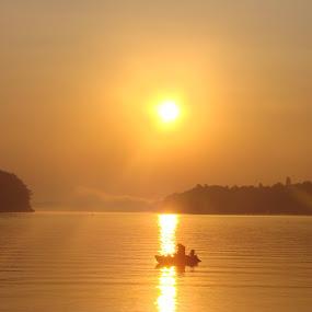 Sunrise over the Danube by Ivan Mendes - Landscapes Sunsets & Sunrises ( lights, water, vukovar, croatia, sunrise, boat, fisherman, light, danube, sun, river )