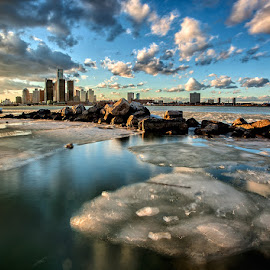 Clouds and Ice by Ray Akey - Landscapes Waterscapes ( water, clouds, michigan, leading lines, waterscape, ice, detroit, landscape, usa, united states, city, river,  )