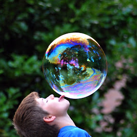At the tip of my tong by Paula Guerra - Babies & Children Child Portraits ( playing, child, bubbles, kids, kids portrait,  )