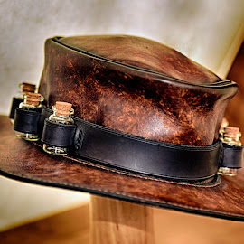 To All Intents And Purposes by Marco Bertamé - Artistic Objects Clothing & Accessories ( cork, belt, vial, brown, bottle, leather, hat )