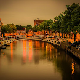 Dokkum evening by Jurica Žumberac - Buildings & Architecture Bridges & Suspended Structures ( water, reflection, holland, long exposure, bridge, cityscape, canal, evening, river, nightscape, city )