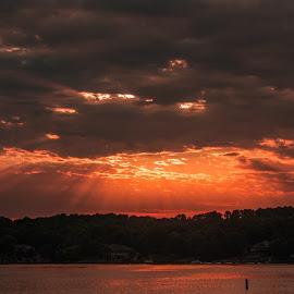 July Sunset by Jennifer  Loper  - Landscapes Sunsets & Sunrises ( sunrays, reflection, sunset, clouds, water )