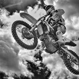 Flying Over by Marco Bertamé - Black & White Sports ( clouds, flying, wheel, motocross, speed, cloudy, air, high, race, noise, jump )