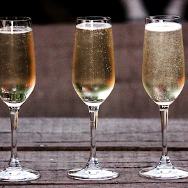 Its Champagne time ! by Anoop Namboothiri - Food & Drink Alcohol & Drinks ( triplets, wooden, champagne, wayside, bubbles, glass, tavern, travel, desk, city )