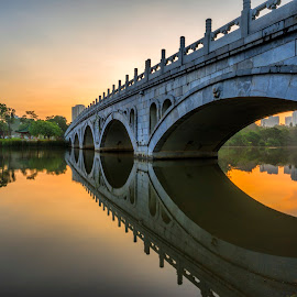 The Japanese Garden by Gordon Koh - City,  Street & Park  City Parks ( water, calm, reflection, architecture, cityscape, singapore, city, tranquil, asia, bridge, sunrise, garden, golden hour )
