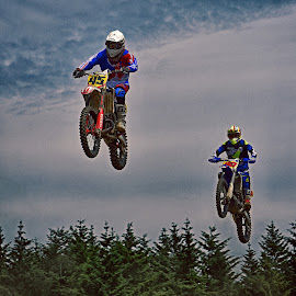 Jumping Duo by Marco Bertamé - Sports & Fitness Motorsports ( two, duo, 45, motocross, blue, green, number, forest, air, forty-five, duel, race, jump, competition,  )