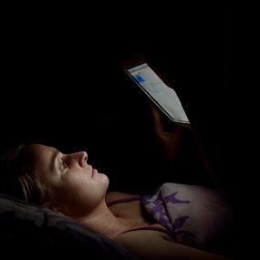 Enlightened by Mariusz Murawski - People Portraits of Women ( black background, woman, bed, ipad, profile, linen )