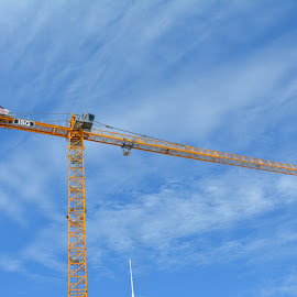 high crane by Dean Moriarty - City,  Street & Park  Skylines ( sky, blue, high loader, yellow, crane )