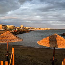 by Bogdan Claudiu - Landscapes Weather ( water, sky, sunset, umbrella, sea, beach, italy )