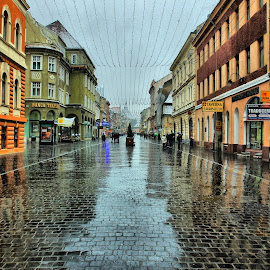 Reflection on the street by Comsa Bogdan - City,  Street & Park  Street Scenes ( republicii, strada republicii, reflection, building, beautiful, street, fun, travel, enjoy, landscape, photography, brasov, gorgeous, comsa bogdan, historical, travel photography, rain, wonderful, romania prin obiectiv )
