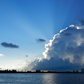 Summer Cloud over Clearwater Beach by Kathy Rose Willis - Landscapes Cloud Formations ( clearwater beach, water, clouds, blue, florida, white, clouds and sea, cloudscape, black, rays )