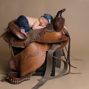 by Nicole Ferris - Babies & Children Babies ( girl, saddle, jeans, baby, sleeping )