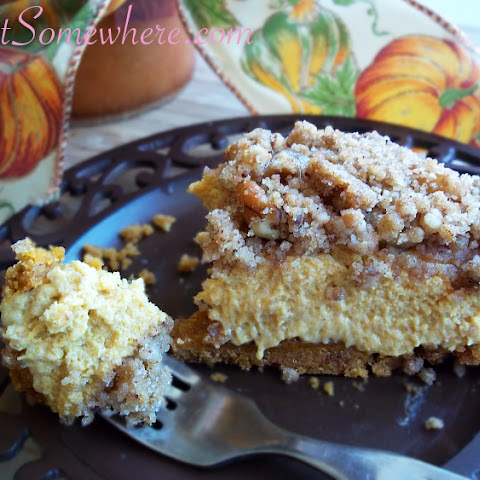 Pumpkin Cheesecake with Cinnamon Streusel Topping and Walnut Pumpkin Snap Cookie Crust