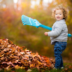 Little Rake by Mike DeMicco - Babies & Children Child Portraits ( child, warm, sweet, rakeing, autumn, rake, fall, little, children, baby, cute, leaves )