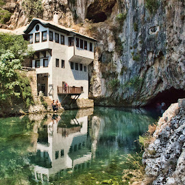 Blagaj (Bosnia Erzegovina) by Gianluca Presto - Buildings & Architecture Homes ( water, home, water reflection, old, reflection, beautiful, stone, reflections, architectural detail, house, architecture, historic, ancient, bosnia, architectural, rocks, river, blagaj )