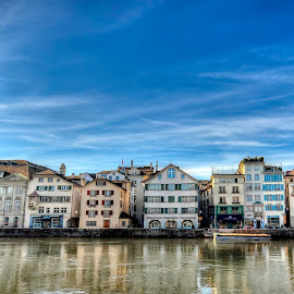 Center of Zurich, Switzerland by Péter Mocsonoky - City,  Street & Park  Street Scenes ( famous, old, zurich, europe, street, cityscape, travel, architecture, limmat, capital, historic, city, center, swiss, sky, riverside, sunny, dramatic, switzerland, district, central, downtown, water, building, church, landmark, urban, tower, european, blue, summer, cathedral, town, view, bridge, waterfront, river )