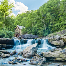 Glade Creek Mill by Norma Brandsberg - Buildings & Architecture Public & Historical ( waterfall, stone, sawmill, flow, boulder, photography, weathered, mill, glade, sky, tree, creek, virginia, meander, perfect, pond, forests, water, picturesque, moving, park, campground, babcock, travasting, photo, log, skies, gristmill, picture, meandering, blue, grain, fall, antique, west )