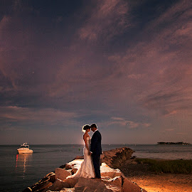 Sunset by the harbor by Joseph Humphries - Wedding Bride & Groom ( harbor, backlight, colors, wedding, sunset, marina, boat, backlighting, bride, groom )