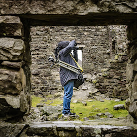 Through The Square Window by Darrell Evans - People Street & Candids ( building, old, person, window, grass, green, outdoor, male, photographer, stone, adult, square, photography, shooting )