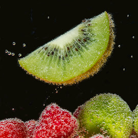 Floating Kiwi  by Jim Downey - Food & Drink Fruits & Vegetables ( sparkling, bubbles, kiwi fruit, limes, raspberries )