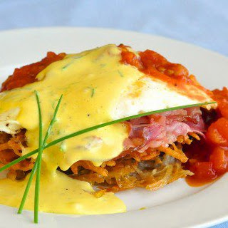 Tomato Eggs Benedict with Potato lakes and Prosciutto