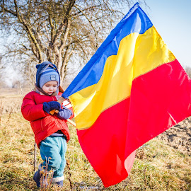 The flag by Dan Orsa - Babies & Children Children Candids ( child, red, flag, blue, national, yelow )