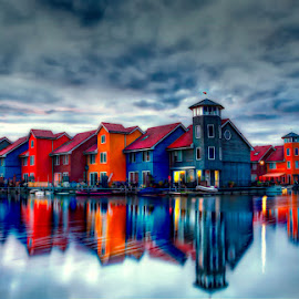 Reitdiephaven by Paolo Testa - Buildings & Architecture Homes ( water, clouds, reflection, houses, sky, sunset, reitdiephaven, dutch, long exposure, cityscape, architecture, homes, landscape, sun, colours )