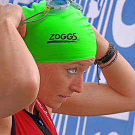 Preparing For Race by Marco Bertamé - Sports & Fitness Swimming ( cap, green, woman, triathlon, concentrated, lady )