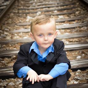 Waiting For The Train by April Sadler - Babies & Children Child Portraits ( #boy #train tracks #boots #park,  )