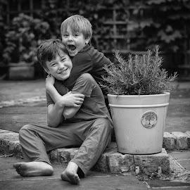 Gabriel & Dash by Dan Horton-Szar ARPS - Babies & Children Child Portraits ( monochrome, hug, black and white, family, boys, children, garden, portrait, brothers,  )