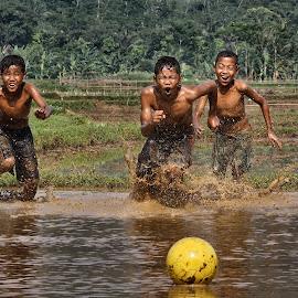 mud soccer by Fritz Basuki - Babies & Children Children Candids