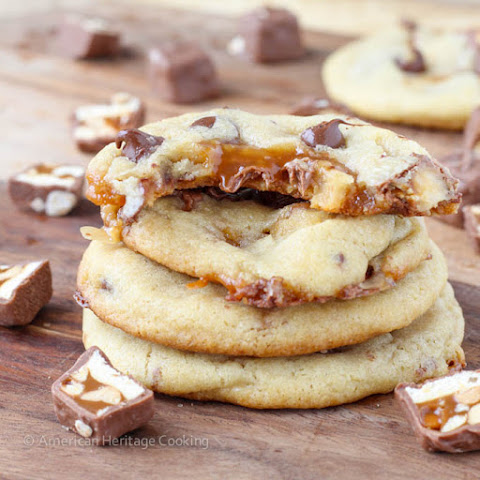 Caramel Stuffed Brown Butter Snickers Chocolate Chip Cookies