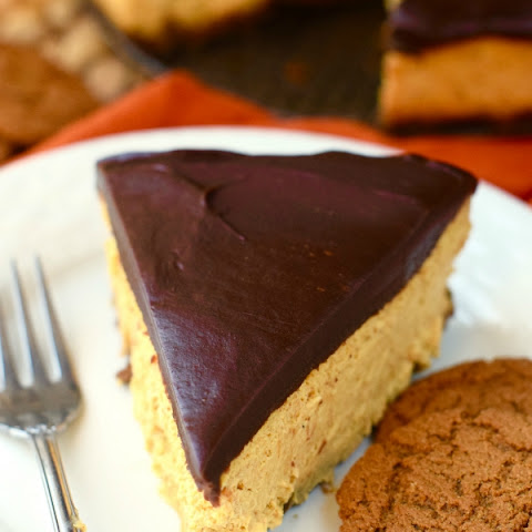 Pumpkin Cheesecake Frosted In Chocolate Ganache