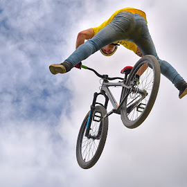 Open Flight by Marco Bertamé - Sports & Fitness Other Sports ( clouds, sky, blue, cloudy, grey, air, yellow, high, stunt, fliying, bicycle, jump )