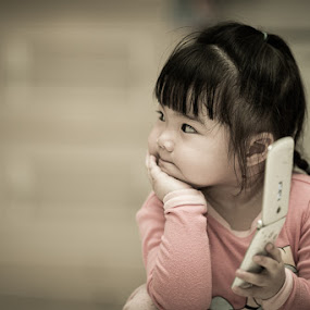 hmm just missed call... by Cuandi Kuo - Babies & Children Children Candids ( d800e, nikon, 200mm f/2 )