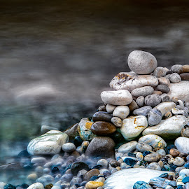 Pile by Darrell Evans - Nature Up Close Rock & Stone ( yorkshie, water, yorkshire, flamborough, sea, ocean, pebbles, seaside, blur, flow, rocks, coast )