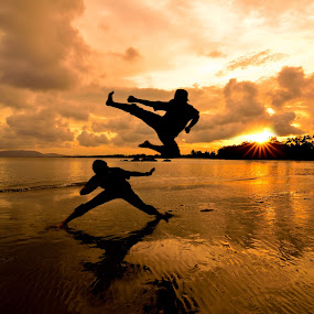 Two Friends fighting by Shahril Khmd - Landscapes Sunsets & Sunrises ( water, fight, death, sea, ocean, beach, hour, sunset, wave, sunrise, dead, golden, friend )
