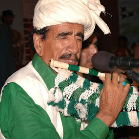 Best flute player, Pakistan by FARAZ AHMED RAJAR - People Musicians & Entertainers ( pakistan, player, flute, dress, green, best, musician, entertainer )
