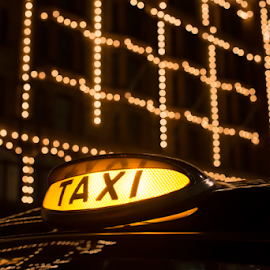 Taxi in London in front of a shopping center by Deyan Georgiev - Transportation Automobiles ( europe, bus, taxi, centre, street, canary, people, city, lights, bond, modern, cab, england, kingdom, neon, construction, light, black, united, uk, november, building, british, decoration, christmas, traffic, great, london, blue, background, night, finance, shopping, wharf, english, britain )