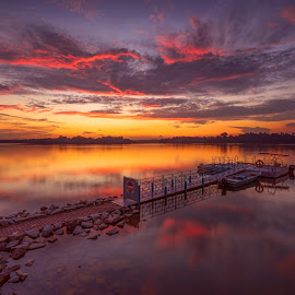 by Gordon Koh - Landscapes Sunsets & Sunrises ( clouds, reflection, nature, sunset, colors, peace, lake, rock, upper seletar reservoir, quiet, colours )