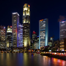 Singapore city by night by Keren Woodgyer - City,  Street & Park  Night ( lights, building, skyscraper, bright, 2016, night, boat, singapore, river, city )