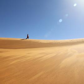Desert Wanderer by Omar Dakhane - Landscapes Deserts ( dunes, north africa, desert, arab, tuareg, sahara desert, travel, landscape, nature, algeria, sahara, africa, alone, man )