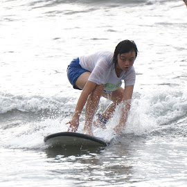 Surving at Kuta Bali by Andi Candrasatria - Sports & Fitness Surfing